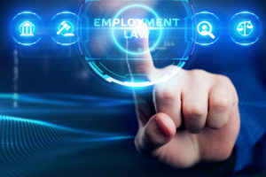 finger pressing on employment law button